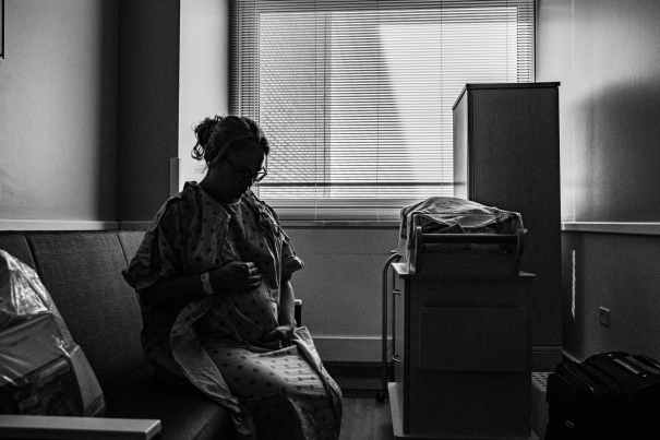 greyscale photo of woman sitting on chair